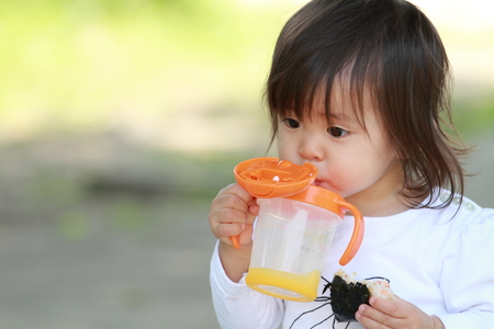 1: Japanese girl drinking water (1 year old)