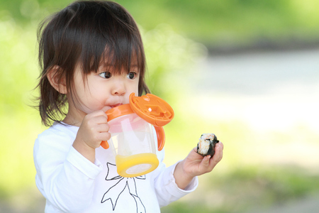 Japanese girl drinking water (1 year old)