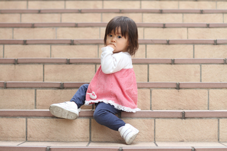 1 year old: Japanese girl sitting on the stairs (1 year old)