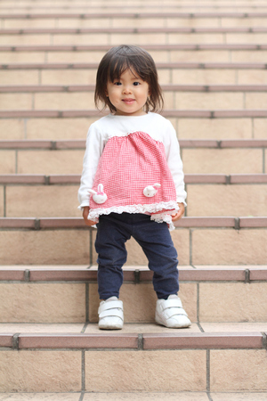 1: Japanese girl standing on the stairs (1 year old)