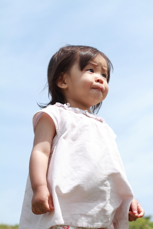 1 year old: Smiling Japanese girl under the blue sky (1 year old)