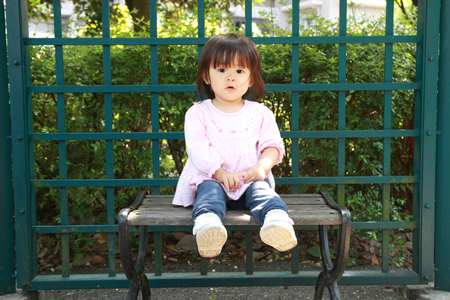 1 year old: Japanese girl sitting on the bench (1 year old)