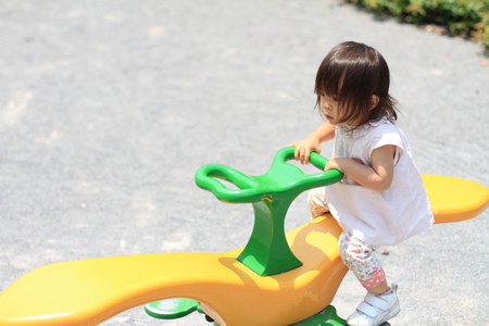 play the old park: Japanese girl on the seesaw (1 year old)