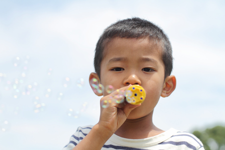 under ground: Japanese boy playing with bubble (first grade at elementary school) Stock Photo