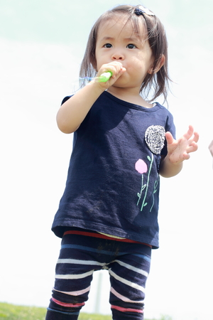 under ground: Japanese girl playing with bubble (1 year old)