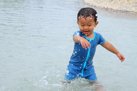 Japanese boy playing with water (1 year old) Stock Photo