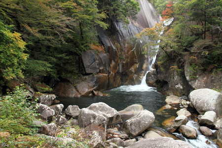 Mitake Shosenkyo gorges and Senga fall with red autumn leaves in Koufu, Yamanashi, Japan