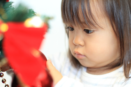Christmas tree and Japanese girl (2 years old) Stock Photo