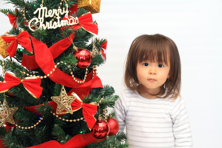 plastic christmas tree: Christmas tree and Japanese girl (2 years old) Stock Photo