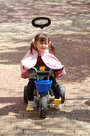 three wheeler: Japanese girl riding on the tricycle (2 years old)
