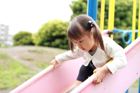 play the old park: Japanese girl on the slide (2 years old)