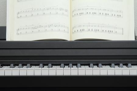 musical score: electric piano and music score Stock Photo
