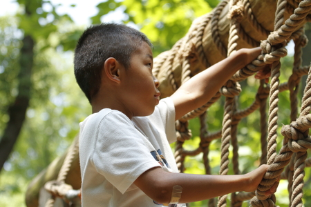 Japanese boy playing with ropewalking (second grade at elementary school) Stock Photo