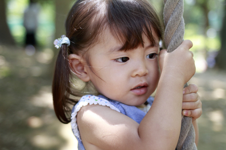 Japanese girl playing with flying fox (2 years old) Stock Photo