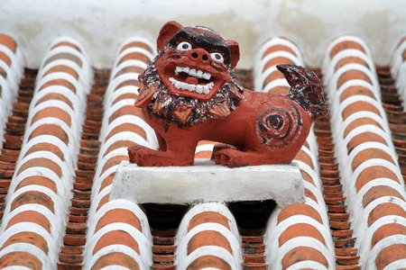 Shisa (guardian from Kingdom of Ryukyu) on the roof in Okinawa, Japan