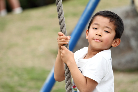 Japanese boy playing with flying fox (first grade at elementary school)