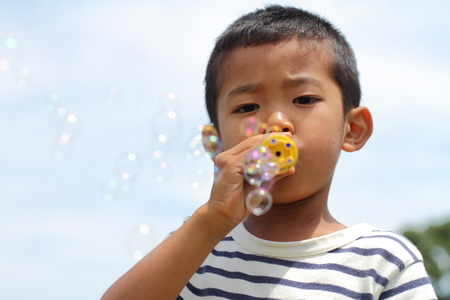 Japanese boy playing with bubble (first grade at elementary school) Stock Photo