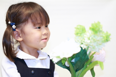Japanese girl in formal wear with flowers (2 years old) Stock Photo