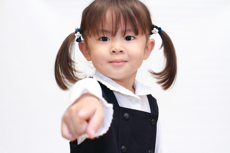 Japanese girl pointing at the camera in formal wear (2 years old) Stock Photo