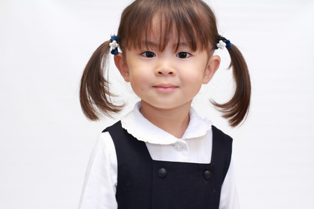 baby facial expressions: Japanese girl in formal wear (2 years old) Stock Photo