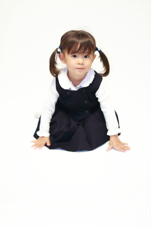 Japanese girl on the floor in formal wear (2 years old)