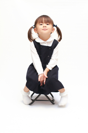 Japanese girl on the chair in formal wear (2 years old)