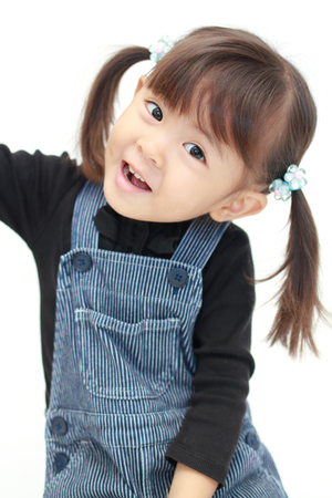 smiling Japanese girl (3 years old) (white back) 免版税图像