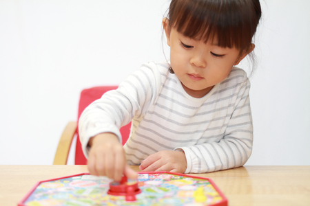Japanese girl playing with boardgame (3 years old)