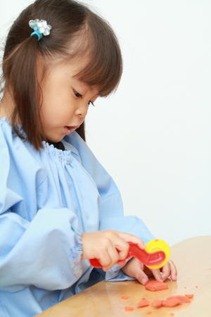 Japanese girl playing with clay (3 years old)