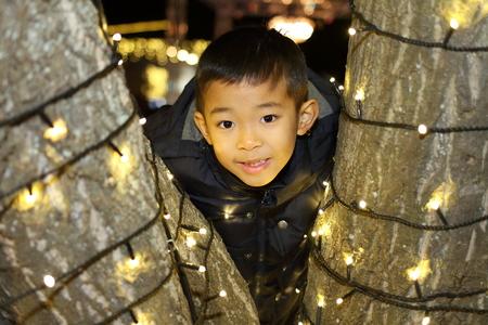 Christmas illumination and Japanese boy (second grade at elementary school) Stock fotó