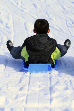 Japanese boy on the sled (second grade at elementary school)