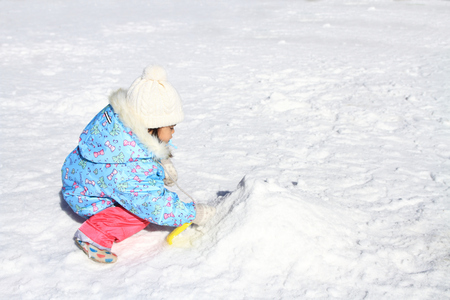 Japanese girl playing in the snow (3 years old)
