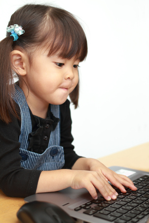 Japanese girl using notebook PC (3 years old)