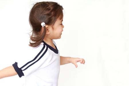 running Japanese girl in sportswear (3 years old)