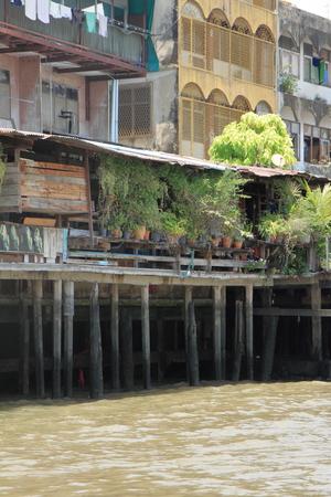 floating house on Chao Phraya river, Bangkok, Thailand 写真素材