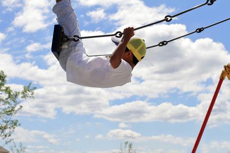 Japanese boy on the swing (third grade at elementary school) 写真素材