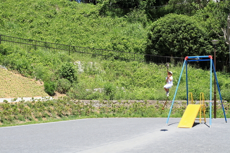 Japanese boy playing with flying fox (third grade at elementary school)