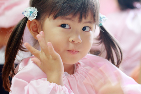 Japanese girl in playwear in her classroom (3 years old) (white back) Stock Photo