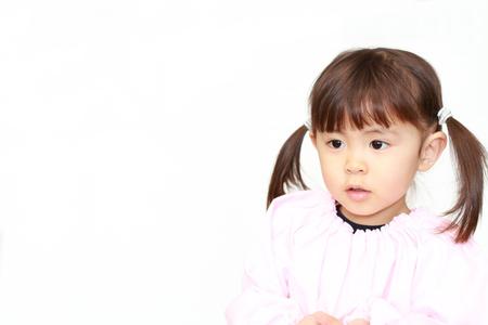 Japanese girl in playwear (3 years old) (white back) 写真素材