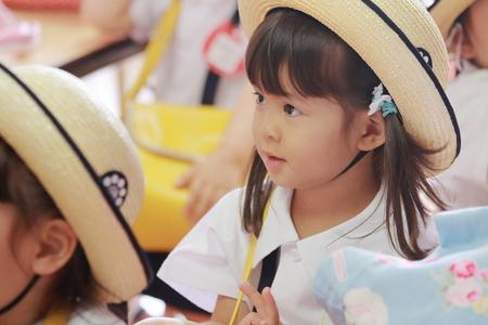 Japanese girl in kindergarten uniform in her classroom in summer (3 years old)