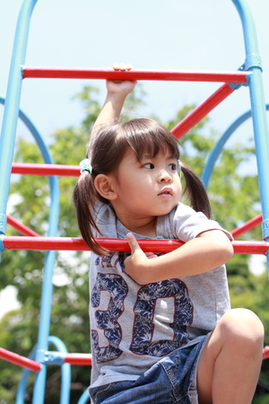 Japanese girl on the jungle gym (3 years old) 写真素材