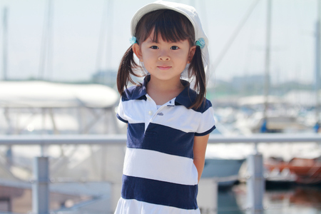 smiling Japanese girl at harbor (3 years old)