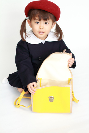 Japanese girl in kindergarten uniform (3 years old) (high angle) (white back) 写真素材