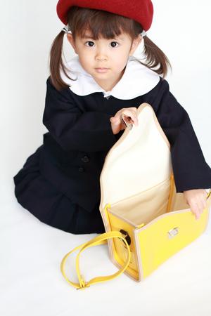 Japanese girl in kindergarten uniform (3 years old) (high angle) (white back) Stock Photo