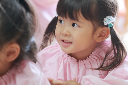 Japanese girl in playwear in her classroom (3 years old) (white back) 写真素材