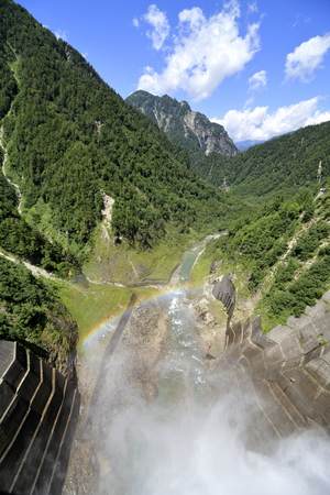 discharge from Kurobe dam with rainbow in Toyama, Japan