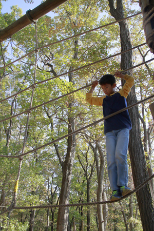Japanese boy playing with ropewalking (third grade at elementary school)