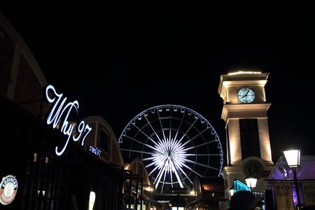 observation wheel and clock tower in Asiatique, Bangkok, Thailand (night scene)