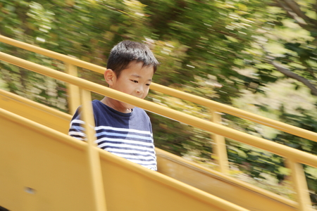 Japanese boy on the slide (fourth grade at elementary school) Imagens - 124942158