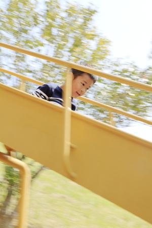 Japanese boy on the slide (fourth grade at elementary school)